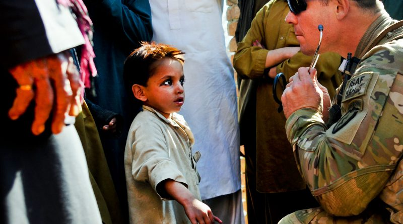 U.S. Army Specialist Joe Kunsch performs medical checks on village children during combat patrol in Khowst province, Afghanistan, Jan. 25, 2012. (Staff Sgt. Jason Epperson/U.S. Army)