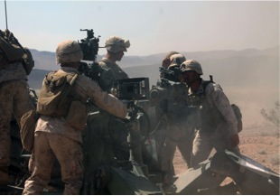 Marines entered the target's coordinates into the howitzer's GPS. (Matt Yurus/MEDILL NSJI )