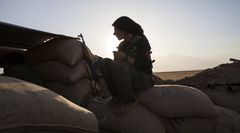 A FIGHTER OF THE KURDISH WOMEN'S DEFENSE UNITS (YPJ) (FABIO BUCCIARELLI/AFP/GETTY IMAGES)